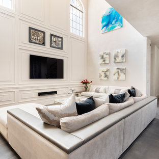 Example of a large trendy open concept porcelain tile and gray floor living room design in Orlando with white walls, a wall-mounted tv and no fireplace