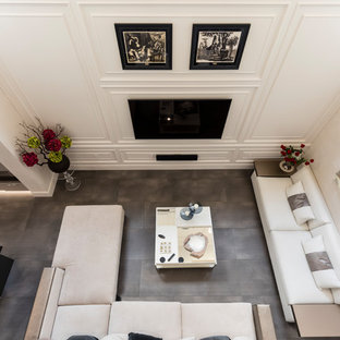 Large trendy formal and open concept porcelain floor and gray floor living room photo in Orlando with white walls and a wall-mounted tv