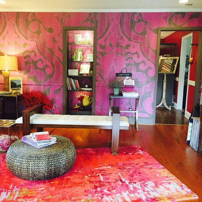 Inspiration for a contemporary medium tone wood floor living room remodel in Orange County with purple walls
