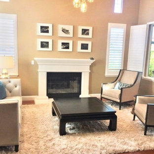 Medium sized formal enclosed living room in San Francisco with medium hardwood flooring, a standard fireplace, a wooden fireplace surround and beige floors.