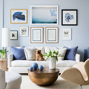 Inspiration for a beach style formal living room remodel in Orange County with blue walls