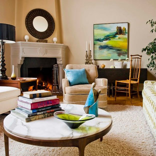 Design ideas for a medium sized eclectic enclosed living room in San Francisco with beige walls and a corner fireplace.