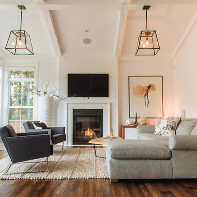 Living room - transitional medium tone wood floor living room idea in Other with white walls, a standard fireplace and a wall-mounted tv