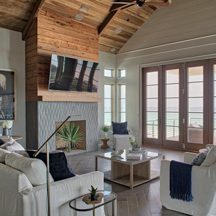 Example Of A Coastal Open Concept Brown Floor Living Room Design In Other With Beige Walls