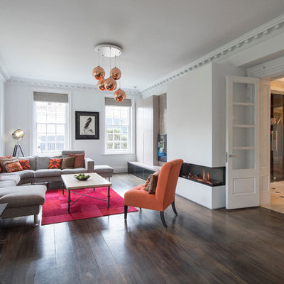 Inspiration for a contemporary formal and enclosed dark wood floor and brown floor living room remodel in London with white walls and a ribbon fireplace