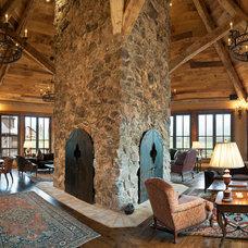 Rustic Living Room by Djuna Design Studio