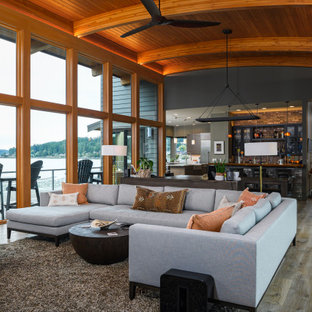 Inspiration for a contemporary medium tone wood floor and brown floor living room remodel in Seattle with gray walls