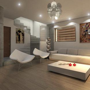 Diseño de salón para visitas cerrado, minimalista, grande, con paredes beige, suelo laminado y suelo beige