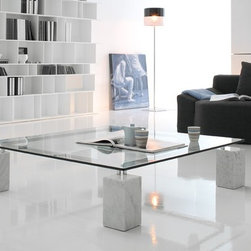 Dielle Coffee Table by Cattelan Italia - Coffee table with base available in two heights, in Travertine, white Carrara or black Marquinia marble. Chromed or black metal bars. Clear glass top.