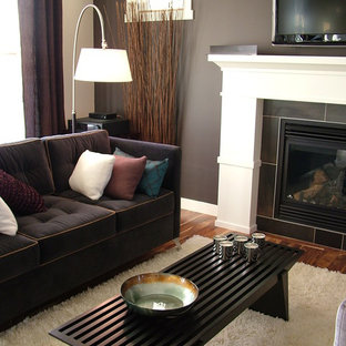 Trendy living room photo in Calgary with a tile fireplace