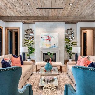 オーランドの大きいトランジショナルスタイルのおしゃれな独立型リビング (白い壁、標準型暖炉、コンクリートの暖炉まわり、テレビなし、フォーマル、無垢フローリング) の写真