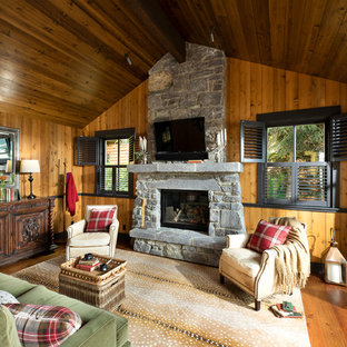 Example Of A Mountain Style Medium Tone Wood Floor And Brown Floor Living  Room Design With