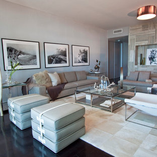 Example of a large trendy black floor living room design in Miami with gray walls