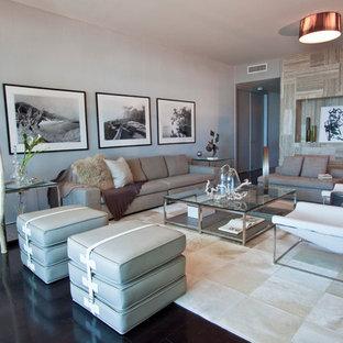Foto di un grande soggiorno minimal con pareti grigie e pavimento nero