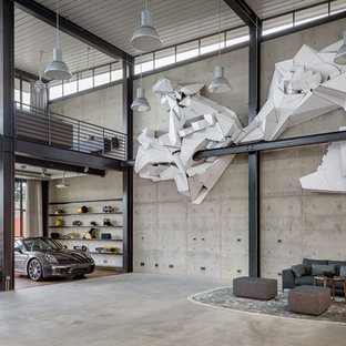 Living room - huge industrial concrete floor and gray floor living room idea in Seattle with gray walls