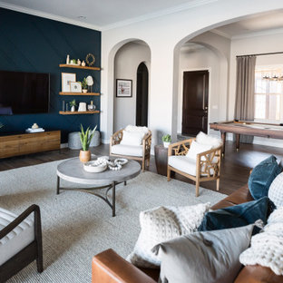 Inspiration for a mid-sized eclectic open concept brown floor living room remodel in Phoenix with blue walls and a wall-mounted tv