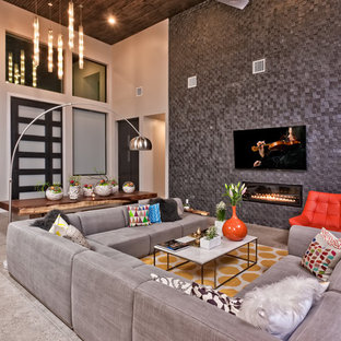 Inspiration for a mid-sized contemporary open concept and formal porcelain floor living room remodel in Austin with gray walls, a ribbon fireplace, a tile fireplace and a wall-mounted tv