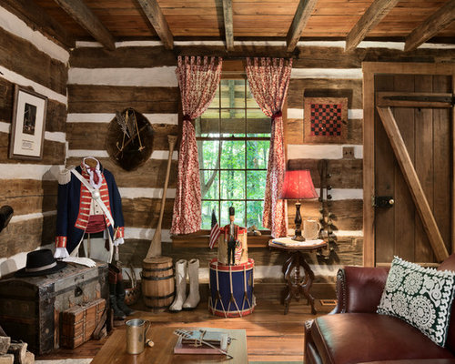 Inspiration For A Rustic Living Room Remodel In Other With Brown Walls Medium Tone Wood