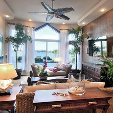 Tropical Living Room by Doris Clements Interiors