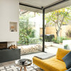 Room Tour: A Modern Extension Shows Off the Magic of Raw Concrete