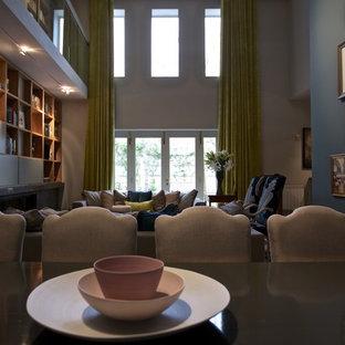 Foto di un grande soggiorno contemporaneo stile loft con libreria, pareti grigie, pavimento in marmo, camino lineare Ribbon, cornice del camino in pietra e nessuna TV