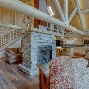 Double Sided Stacked Stone Fireplace with Barn Wood Mantels