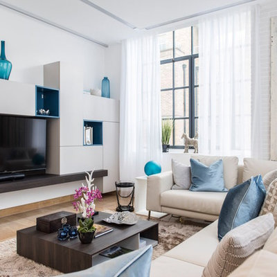 Trendy brown floor living room photo in London with white walls and a wall-mounted tv