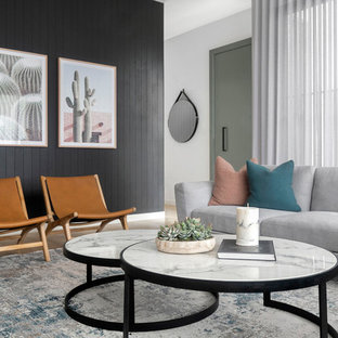 Contemporary formal living room in Sydney with black walls and planked wall panelling.