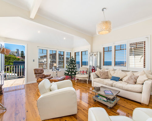 Transitional Living Room In Sydney With Beige Walls, Medium Hardwood  Floors, No Fireplace And