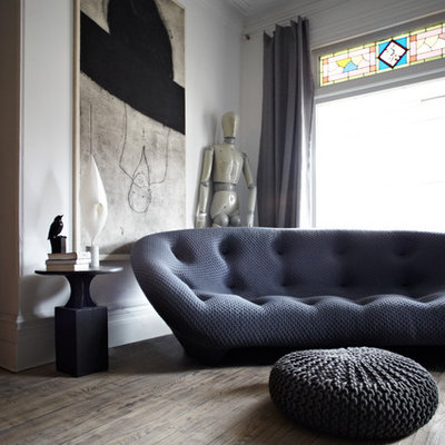 Example of a trendy dark wood floor living room design in Toronto with white walls