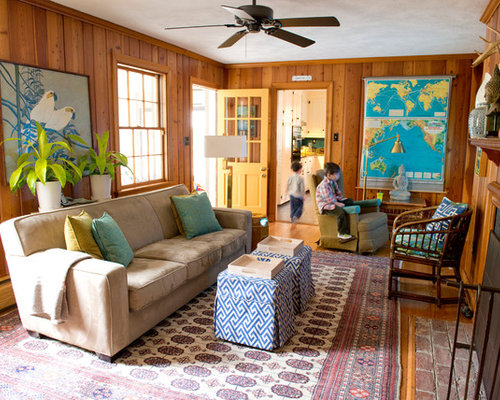 Example Of A Mid Sized Eclectic Enclosed Medium Tone Wood Floor Living Room Design In