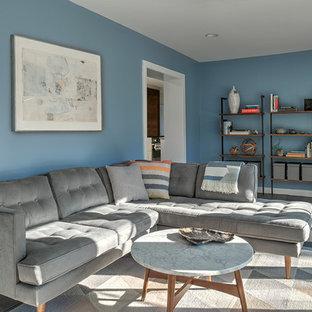 Aménagement d'un salon rétro de taille moyenne avec un sol en ardoise, aucune cheminée et un mur bleu.