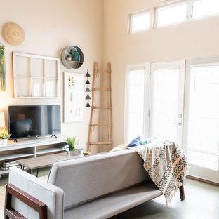 Modelo de salón minimalista, pequeño, con suelo de cemento y suelo verde