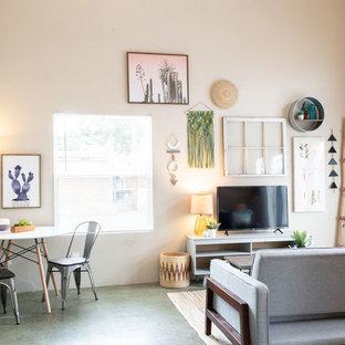 Foto de salón moderno, pequeño, con suelo de cemento y suelo verde