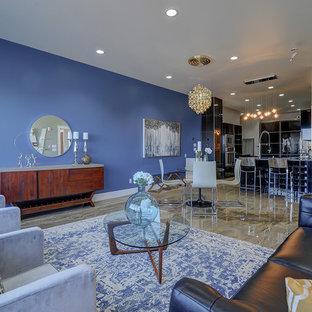 エドモントンの大きいコンテンポラリースタイルのおしゃれなLDK (マルチカラーの壁、コンクリートの床、テレビなし、フォーマル、暖炉なし、ベージュの床) の写真