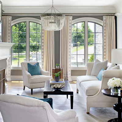 Inspiration for a timeless formal medium tone wood floor living room remodel in Philadelphia with gray walls, a standard fireplace and no tv