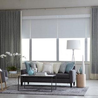 Diseño de salón para visitas cerrado, tradicional, grande, sin chimenea y televisor, con paredes grises, suelo de baldosas de porcelana y suelo gris