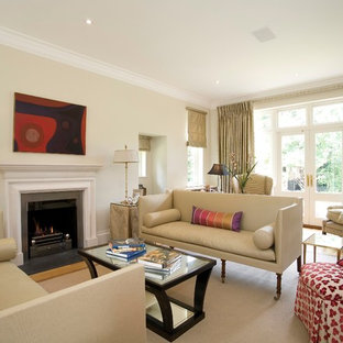 This is an example of a large classic formal living room in Other with beige walls, medium hardwood flooring, a standard fireplace and a metal fireplace surround.