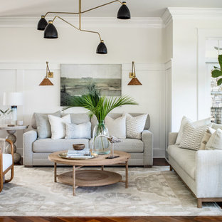 Inspiration for a huge coastal open concept medium tone wood floor and red floor living room remodel in Other with white walls, a standard fireplace, a stone fireplace and a wall-mounted tv