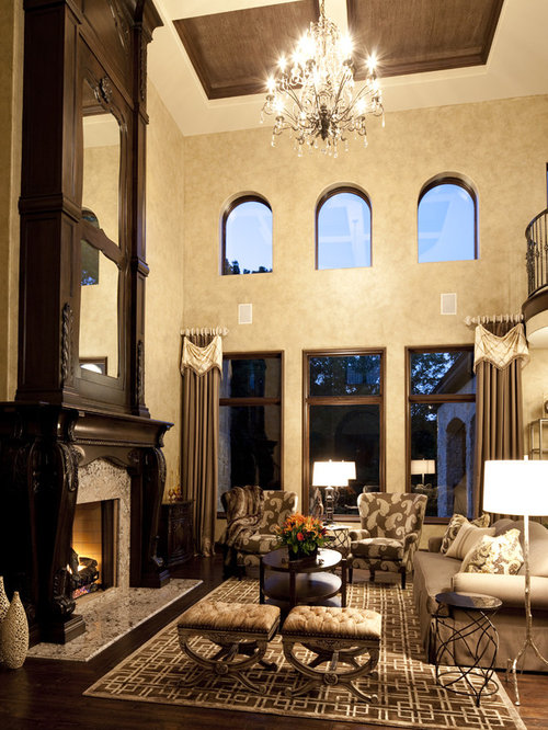 Example of a classic living room design in Indianapolis with beige walls dark hardwood floors