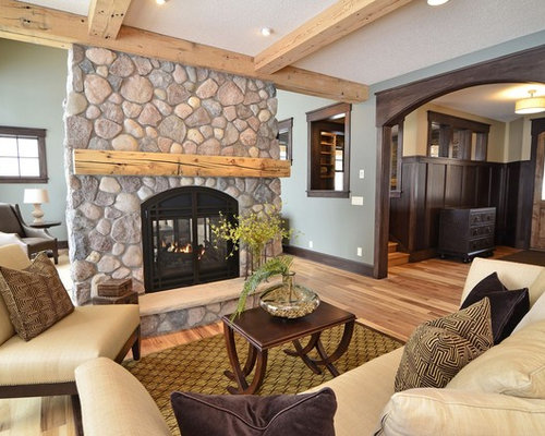 Inspiration For A Timeless Living Room Remodel In Minneapolis With Green  Walls And A Stone Fireplace
