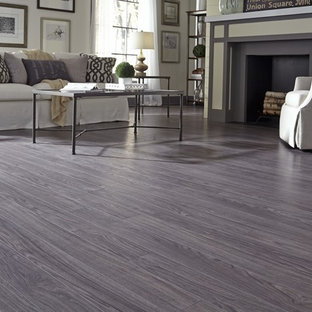 Example of a large trendy formal and open concept medium tone wood floor and gray floor living room design in Other with beige walls