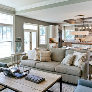 Example of a transitional open concept living room design in DC Metro with gray walls