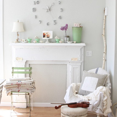 Living room - shabby-chic style medium tone wood floor living room idea in Other with gray walls