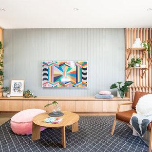 ホバートのコンテンポラリースタイルのおしゃれな独立型リビング (フォーマル、グレーの壁、コンクリートの床、暖炉なし、テレビなし、グレーの床、パネル壁) の写真
