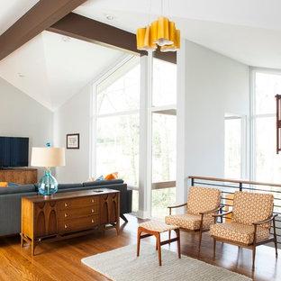 Diseño de salón para visitas abierto, retro, con televisor independiente