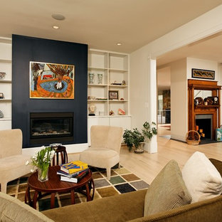 Inspiration for a mid-sized transitional formal and enclosed light wood floor and beige floor living room remodel in DC Metro with a standard fireplace, no tv, white walls and a metal fireplace