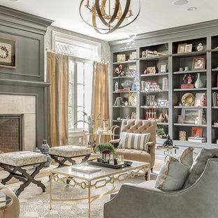 Ejemplo de salón para visitas abierto, clásico renovado, grande, con paredes grises, suelo de madera en tonos medios y televisor colgado en la pared