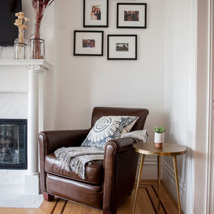 Living room - small contemporary enclosed light wood floor and beige floor living room idea in San Francisco with white walls, a standard fireplace, a wall-mounted tv and a tile fireplace