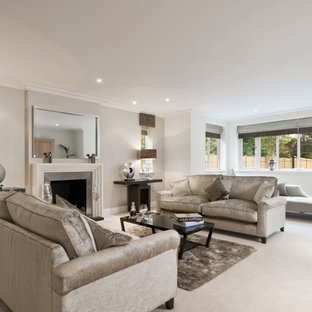 Design ideas for a medium sized contemporary formal living room in Buckinghamshire with beige walls, carpet, a standard fireplace, a metal fireplace surround, beige floors and no tv.